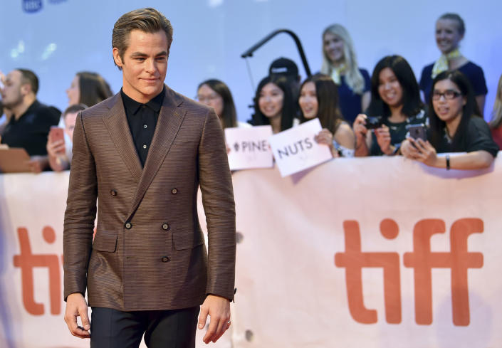 """FILE - Chris Pine attends the gala for """"Outlaw King"""" as his fans carry a """"Pine Nuts"""" sign on day 1 of the Toronto International Film Festival on Sept. 6, 2018, in Toronto. Pine turns 40 on Aug. 26. (Photo by Evan Agostini/Invision/AP, File)"""
