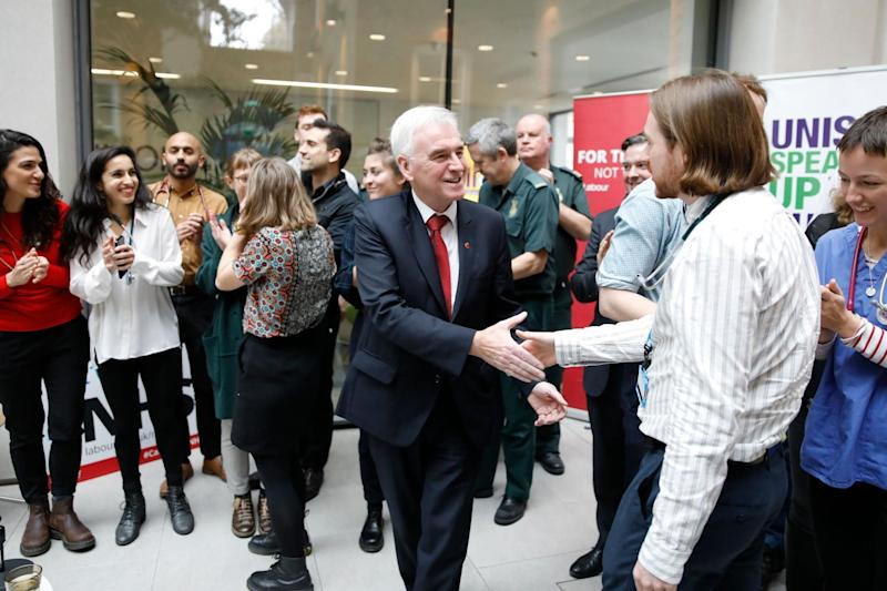 Shadow Chancellor John McDonnell meets NHS staff in central London: AFP via Getty Images