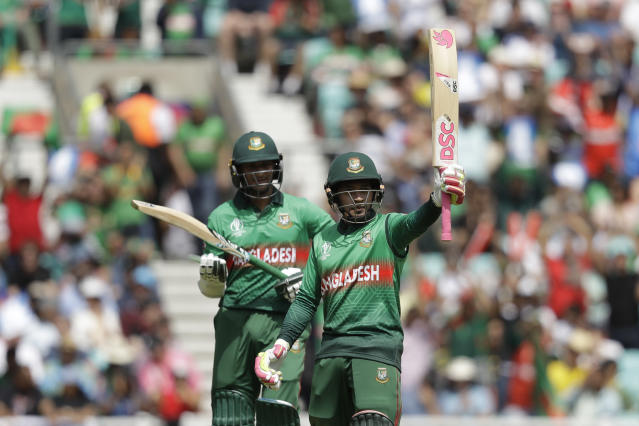 Bangladesh's Mushfiqur Rahim, right, celebrates reaching 50 runs next to Bangladesh's Shakib Al Hasan during the Cricket World Cup match between South Africa and Bangladesh at the Oval in London, Sunday, June 2, 2019. (AP Photo/Matt Dunham)