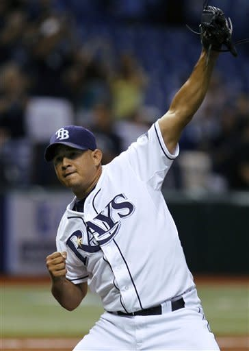 Tampa Bay Rays relief pitcher Joel Peralta reacts after closing out the Seattle Mariners during the ninth inning of a baseball game, Wednesday, May 2, 2012, in St. Petersburg, Fla. The Rays won the game 5-4. (AP Photo/Chris O'Meara)