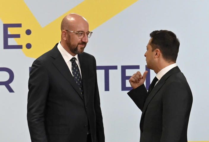 Ukrainian President Volodymyr Zelenskyy, right, and European Council President Charles Michel talks during the Crimean Platform Summit in Kyiv, Ukraine, Monday, Aug. 23, 2021. The Crimea Platform is a new international consultation and coordination format to strengthen an international response to the ongoing Russia's occupation of Crimea. (Ukrainian Presidential Press Office via AP)