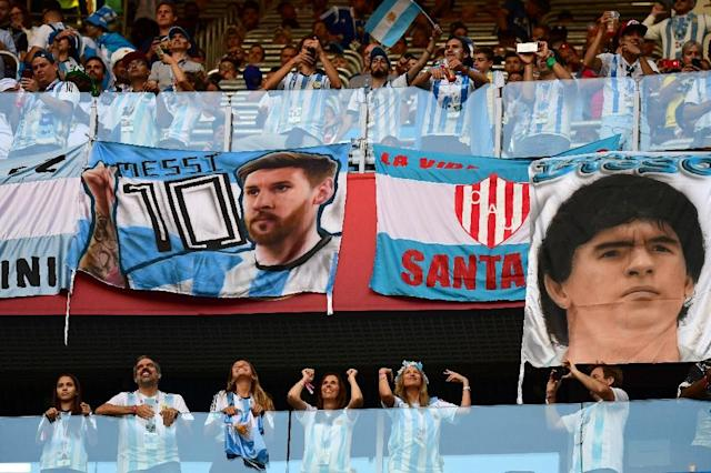 Lionel Messi and Diego Maradona are intertwined in Argentina's football legend (AFP Photo/Giuseppe CACACE)