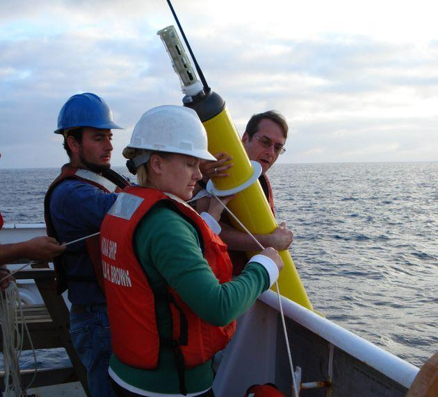 This photo provided by NOAA Corps shows an Argo float being deployed to capture ocean temperature data.