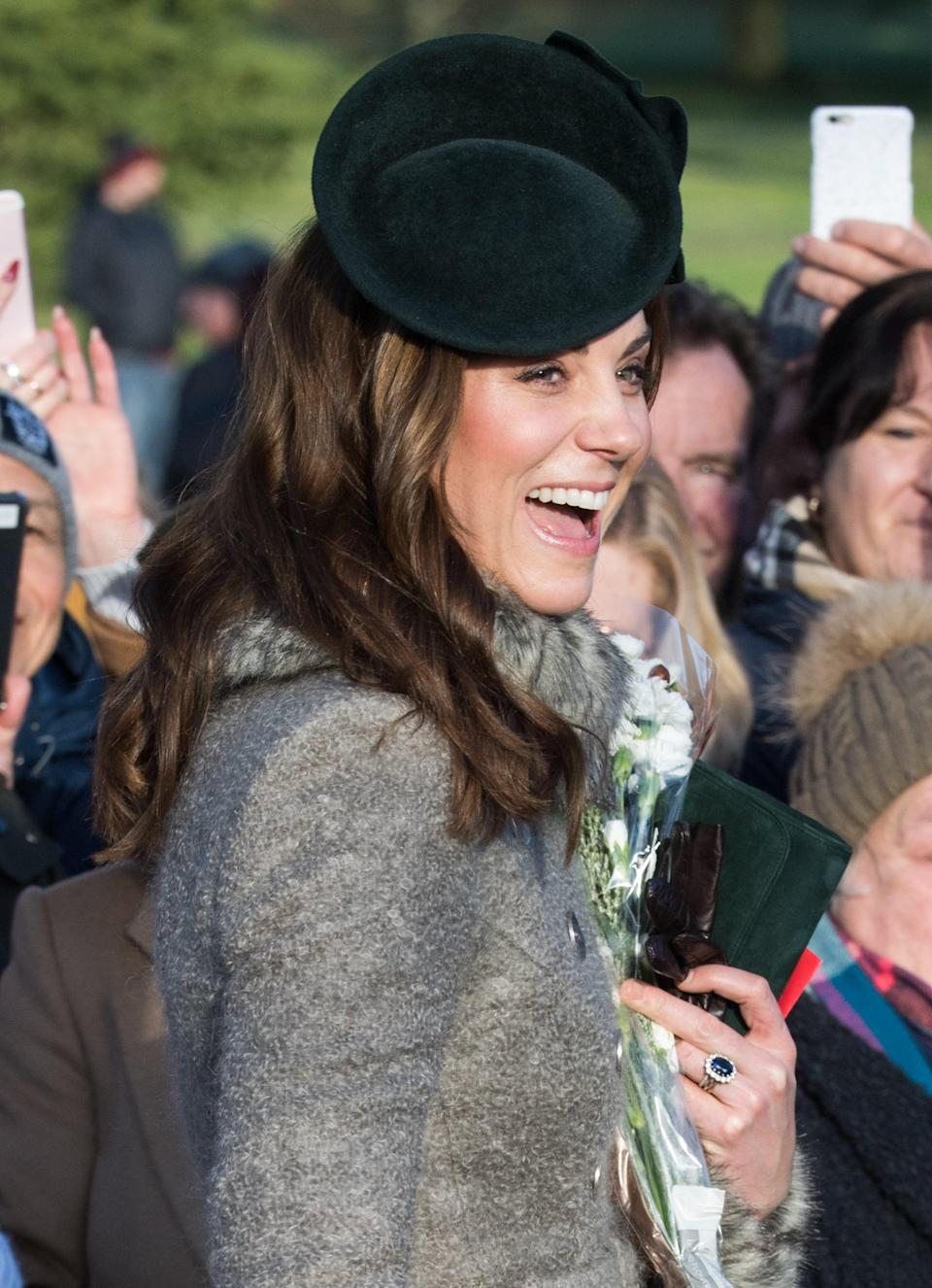 <p>The duchess celebrated Christmas Day mass wearing a gorgeous velvet green fascinator, which she paired with low-key rope-like waves. </p>