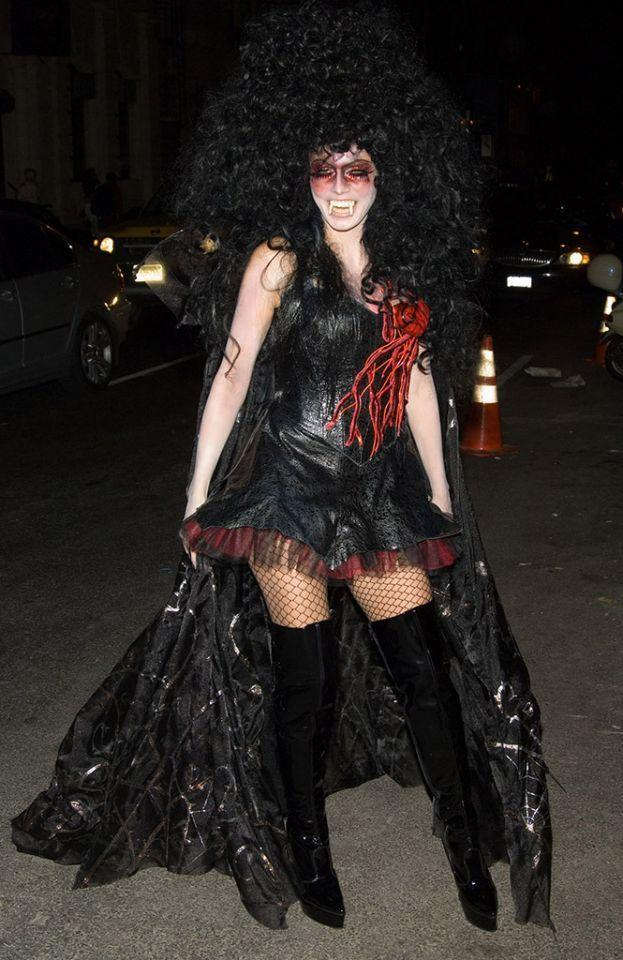 <p>No. 14: Klum was ready to suck some blood in 2005. Her fanged vampire costume was big and bold, from the huge curly black wig to the giant wings. An added touch was the exposed heart. The only thing was, it wasn't all that different from her witch outfit the year before — that too centered around a giant, out-of-control wig — making it less of a standout. (Photo: Lawrence Lucier/FilmMagic) </p>