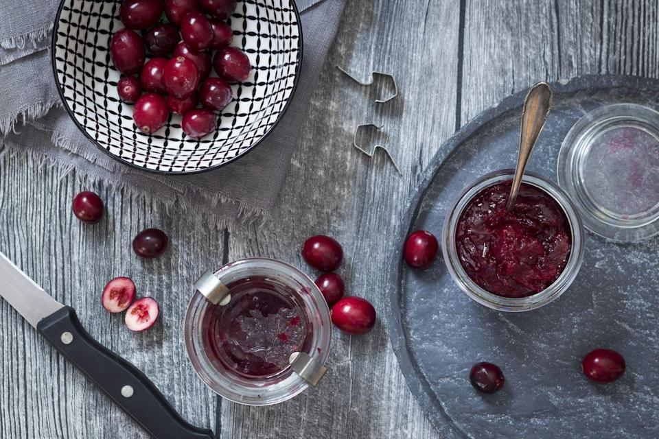 """<p>Cranberries are one of the only fruits native to America and were known to be regularly consumed by <a href=""""https://www.canr.msu.edu/news/why_do_we_eat_cranberries_at_thanksgiving"""" rel=""""nofollow noopener"""" target=""""_blank"""" data-ylk=""""slk:Native Americans"""" class=""""link rapid-noclick-resp"""">Native Americans</a>, though we can't say for sure that they ate them on the first Thanksgiving.</p><p>Still, the sweet cranberry sauce we know and love today probably didn't materialize until the late 17th century, when Native American recipes of cranberries made with sugar and water were uncovered. <em><a href=""""https://www.washingtonpost.com/lifestyle/food/a-short-course-on-the-history-of-8-thanksgiving-foods/2013/11/22/944b345e-40b3-11e3-9c8b-e8deeb3c755b_story.html?utm_term=.ea77fea75e8c"""" rel=""""nofollow noopener"""" target=""""_blank"""" data-ylk=""""slk:The Washington Post"""" class=""""link rapid-noclick-resp"""">The Washington Post</a></em> says the first cranberry sauce recipe can be found in the 1796 cookbook <em>American Cookery</em> by Amelia Simmons. Canned cranberry sauce was <a href=""""https://www.smithsonianmag.com/arts-culture/this-man-made-the-first-canned-cranberry-sauce-180947862/"""" rel=""""nofollow noopener"""" target=""""_blank"""" data-ylk=""""slk:invented"""" class=""""link rapid-noclick-resp"""">invented</a> by former lawyer, Marcus L. Urann, who quit his job to run a cranberry bog and ended up changing the future of the fruit. </p>"""