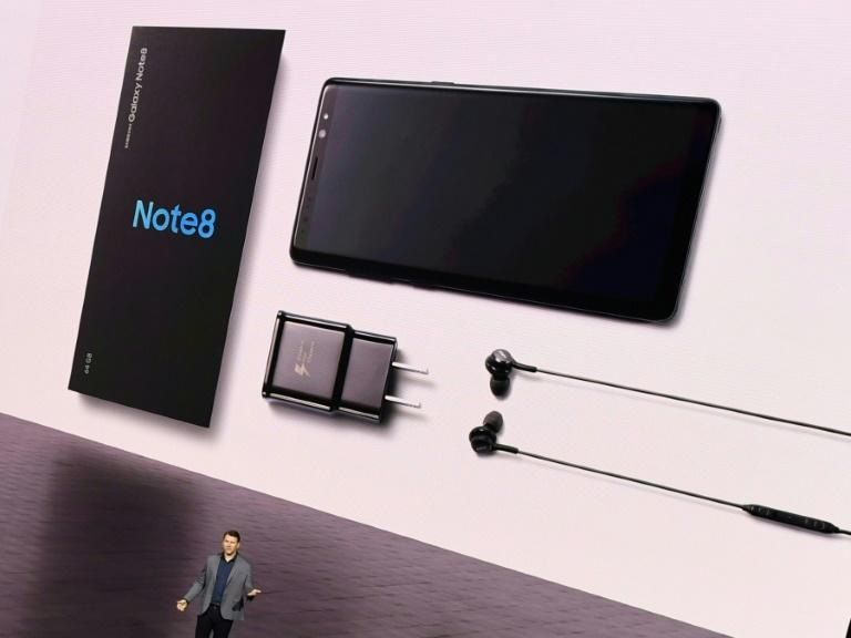 The new Samsung Note 8 smartphone model, displayed on a giant at a launch event in New York