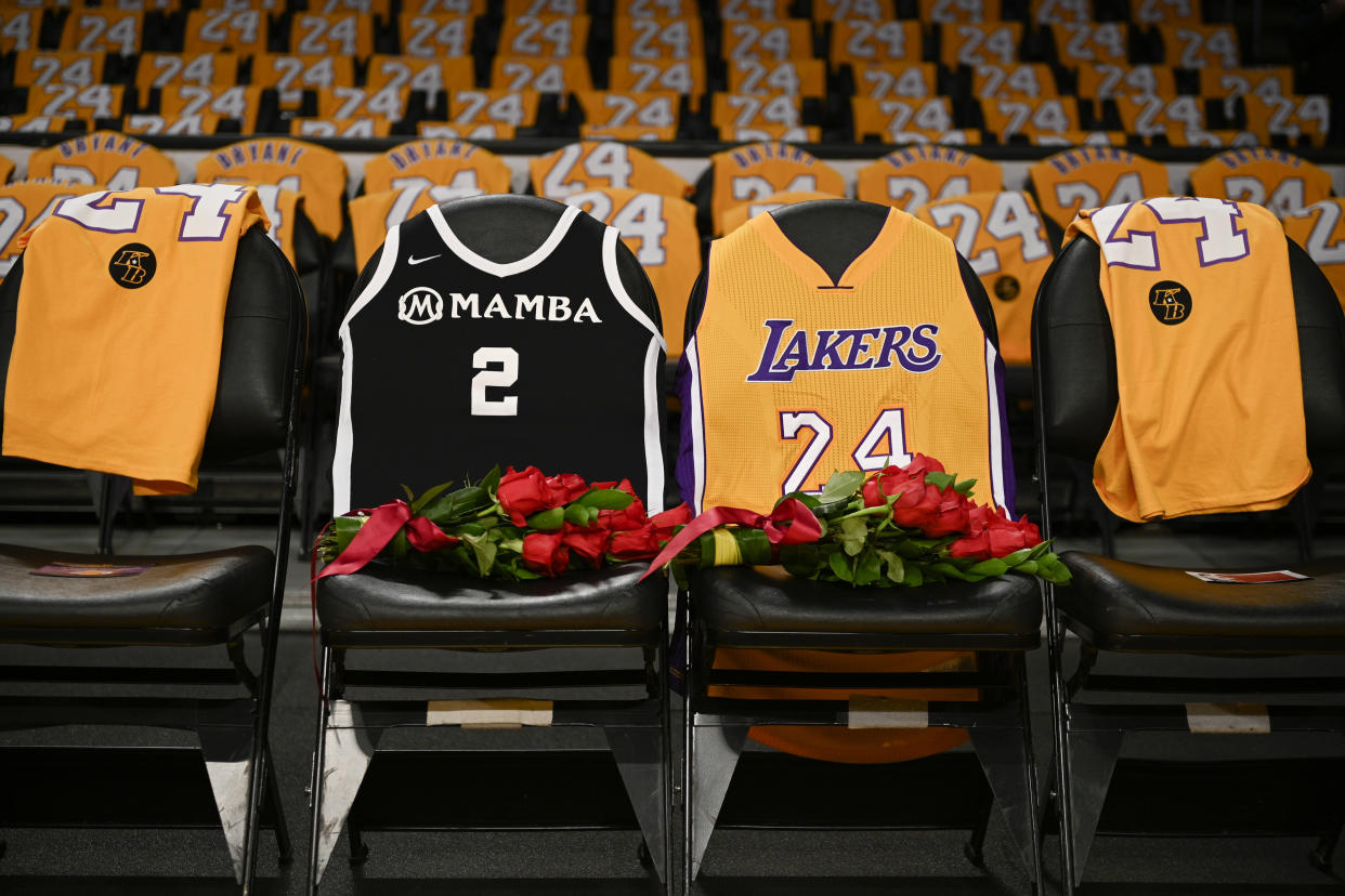 The jerseys of late Los Angeles Laker Kobe Bryant, right, and his daughter Gianna are draped on the seats the two last sat on at Staples Center, prior to the Lakers' NBA basketball game against the Portland Trail Blazers in Los Angeles, Friday, Jan. 31, 2020. The last game the two attended was on Dec. 29, 2019 when the Lakers faced the Dallas Mavericks. (AP Photo/Kelvin Kuo)