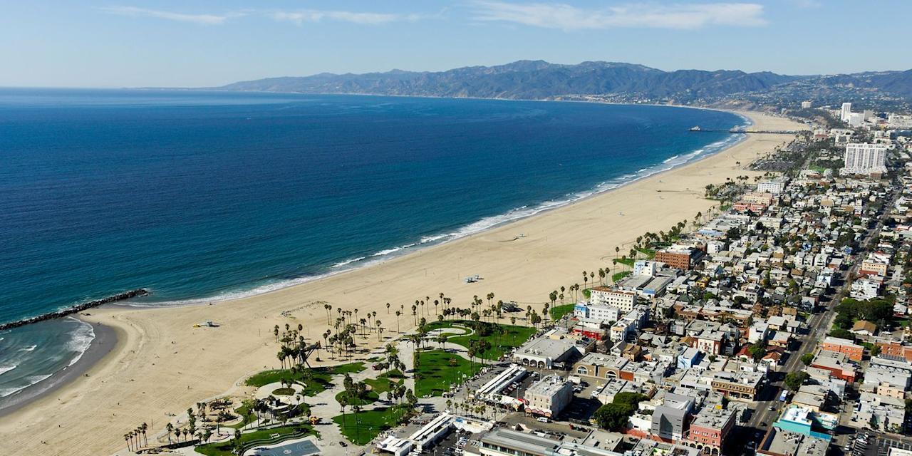 "<p>When it comes to beach towns, Venice Beach is a top choice on our list for its liveliness and carefree culture. Walk the boardwalk and take in the surf's-up spirit of the locals who longboard or roller-skate to get where they're going. </p><p>Don't forget to check out some offerings from the local artists that sell their work right on the boardwalk, hang loose around the skate park nestled right in the sand, or pump some iron at the famous <a href=""https://www.venicebeach.com/muscle-beach-gym/"" target=""_blank"">Muscle Beach Gym</a>. And if you're into music, there's a ton of venues and history at Venice Beach for that, too! </p><p><em><strong>Where to Stay: </strong></em><a href=""https://www.tripadvisor.com/Hotel_Review-g32655-d77804-Reviews-Omni_Los_Angeles_at_California_Plaza-Los_Angeles_California.html"" target=""_blank"">Omni Los Angeles</a>, <a href=""https://www.tripadvisor.com/Hotel_Review-g32655-d17499730-Reviews-Lalola_Venice-Los_Angeles_California.html"" target=""_blank"">Lalola Venice</a></p>"