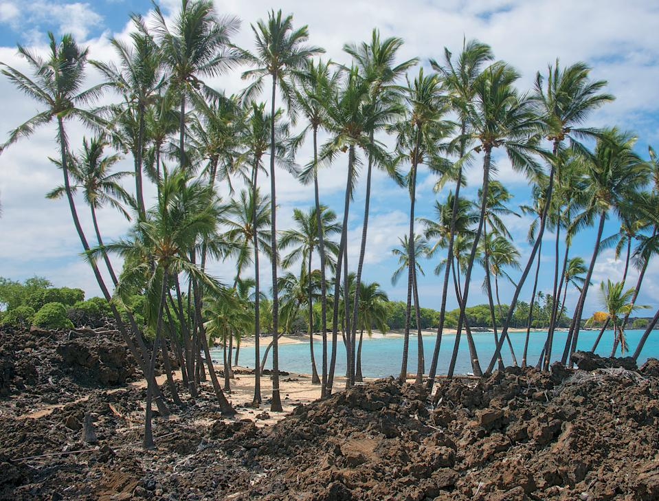 Ala Kahakai National Historic Trail is a 175-mile corridor that takes travelers through lava fields, past beaches (such as Mahai'ula Bay, seen here) and up mountains.