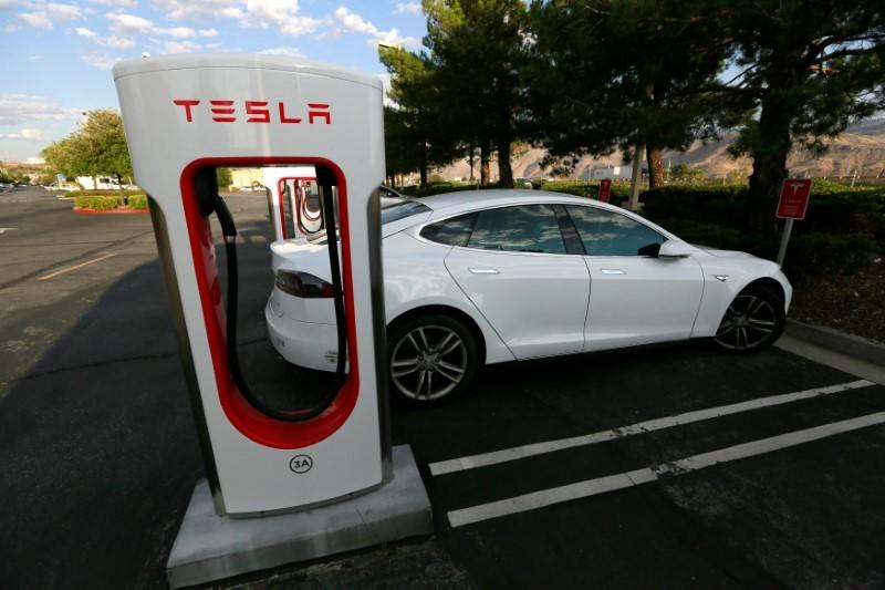 A Tesla Model S charges at a Tesla Supercharger station in Cabazon, California