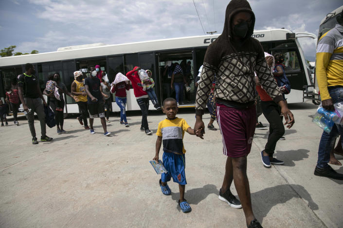 Haitians who were deported from the United States arrive at the Toussaint Louverture International Airport, in Port au Prince, Haiti, Sunday, Sep. 19, 2021. Thousands of Haitian migrants have been arriving to Del Rio, Texas, to ask for asylum in the U.S., as authorities begin to deported them to back to Haiti. (AP Photo/Rodrigo Abd)
