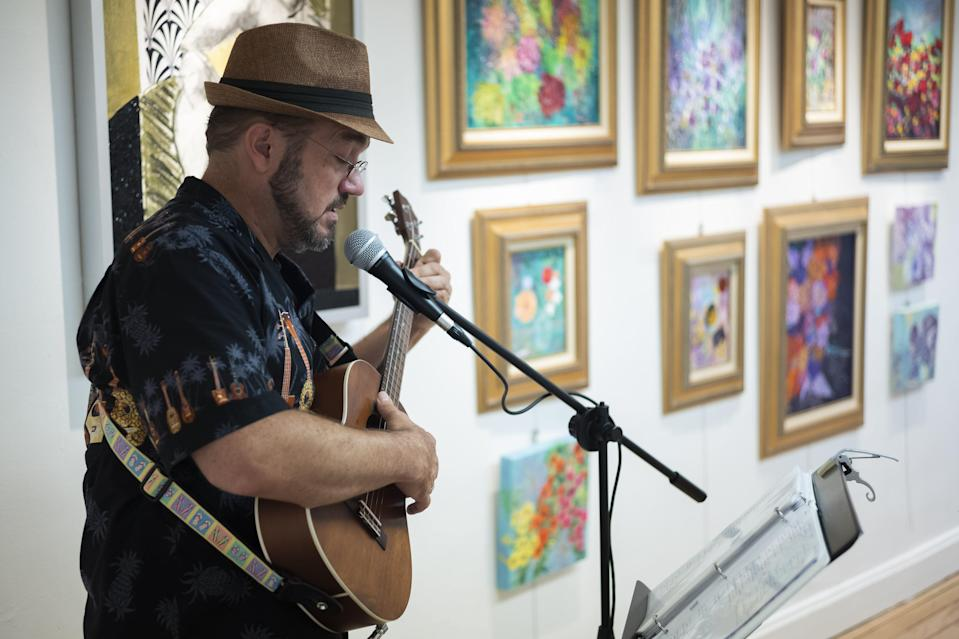 Aaron Minnick, of Columbus. performs during the Hilltop 3060 Art Brunch on Saturday.