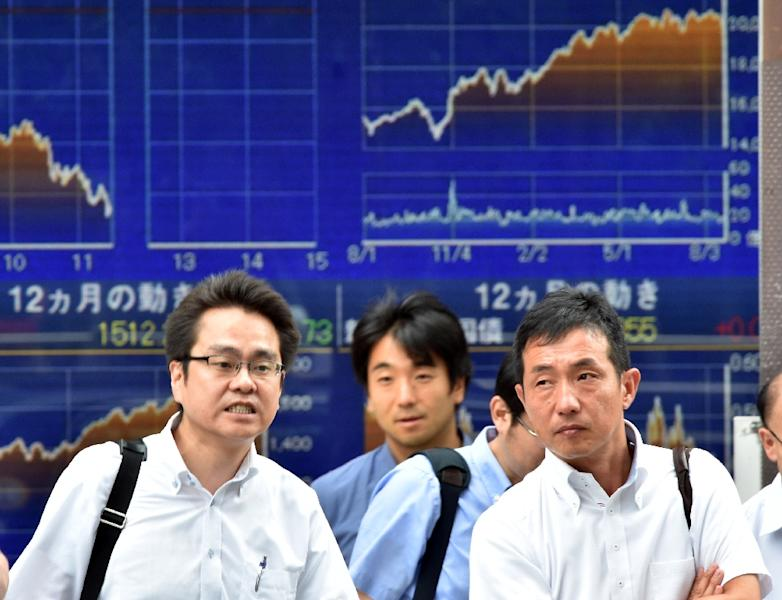 Tokyo closed down 4.61%, or 895.15 points, at a six-month low of 18,540.68 (AFP Photo/Yoshikazu Tsuno)