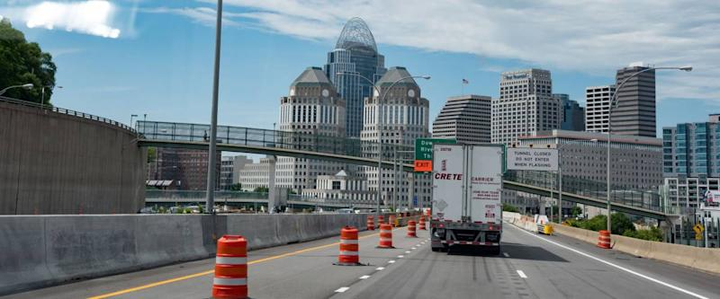 Cincinnati, Ohio/USA-June 10, 2018: A view of the Cincinnati skyline driving south from Interstate 71 with road construction barrels.