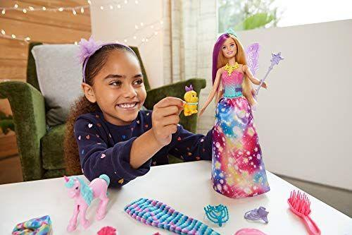 """<p><strong>Barbie</strong></p><p>amazon.com</p><p><strong>$29.99</strong></p><p><a href=""""https://www.amazon.com/dp/B08442WG5D?tag=syn-yahoo-20&ascsubtag=%5Bartid%7C10055.g.4911%5Bsrc%7Cyahoo-us"""" rel=""""nofollow noopener"""" target=""""_blank"""" data-ylk=""""slk:Shop Now"""" class=""""link rapid-noclick-resp"""">Shop Now</a></p><p>Come Christmas Day, Barbie will be decked out with fairy wings, a mermaid tail, and other magical accessories. She won't be alone, though: The advent calendar also comes with four animal friends to keep Barbie company. </p>"""