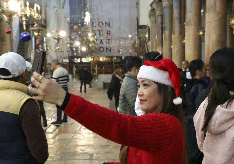 A visitor takes a selfie at the Church of the Nativity in the city of Bethlehem (AFP Photo/HAZEM BADER)