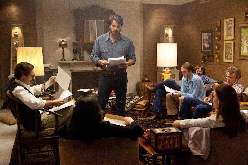 "This film image released by Warner Bros. Pictures shows Ben Affleck as Tony Mendez, center, in ""Argo,"" a rescue thriller about the 1979 Iranian hostage crisis. (AP Photo/Warner Bros., Claire Folger)"