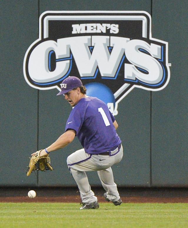 TCU Center fielder Cody Jones chases a ball hit for a double by Virginia's Branden Cogswell in the fifth inning of an NCAA baseball College World Series game in Omaha, Neb., Tuesday, June 17, 2014. (AP Photo/Ted Kirk)