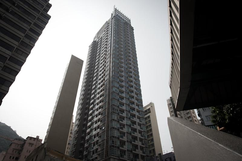 A general view shows the J residence building in Hong Kong where two female corpses, including one in a suitcase, were found following the arrest of British banker Rurik Jutting (AFP Photo/Nicolas Asfouri)