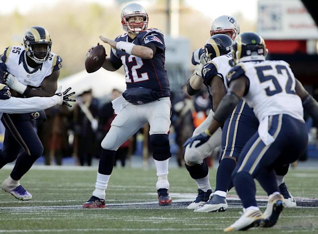 Passing 'em by: Tom Brady is now alone as the winningest quarterback in NFL history. (AP)