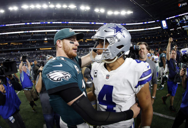 FILE - In this Nov. 19, 2017, file photo, Philadelphia Eagles' Carson Wentz, left, and Dallas Cowboys' Dak Prescott, right, greet each other after their NFL football game, in Arlington, Texas. Prescott and the Cowboys saved their season with a win in Philadelphia a month ago. Now Carson Wentz and the defending champion Eagles are trying to do the same in Texas against first-place Dallas on Sunday. (AP Photo/Ron Jenkins, File)