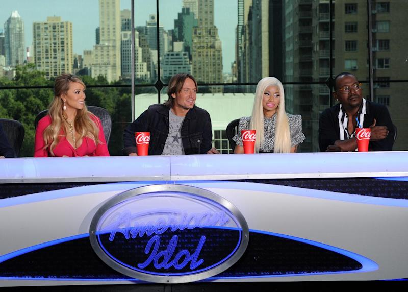 """This image released by Fox shows the new judges for the singing competition series, """"American Idol,"""" from left, Mariah Carey, Keith Urban, Nicki Minaj and Randy Jackson during a news conference in New York on Monday Sept. 17, 2012. (AP Photo/FOX, Michael Becker)"""