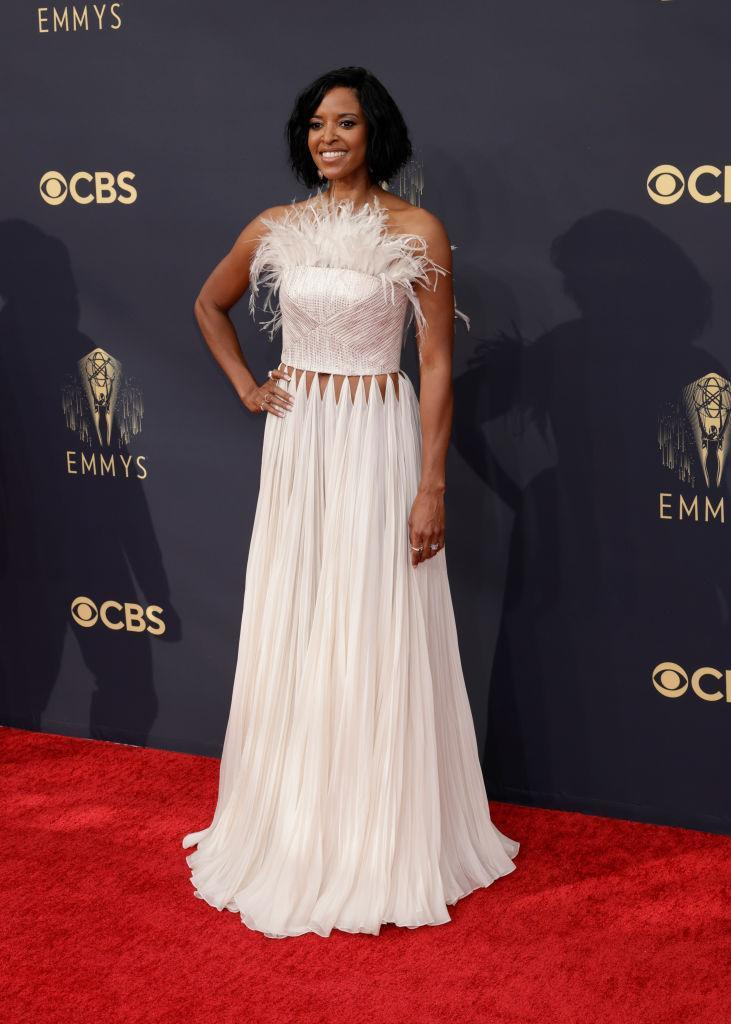Renee Elise Goldsberry looked stunning in a feather trimmed gown with cut-out stomach detailing. (Getty Images)