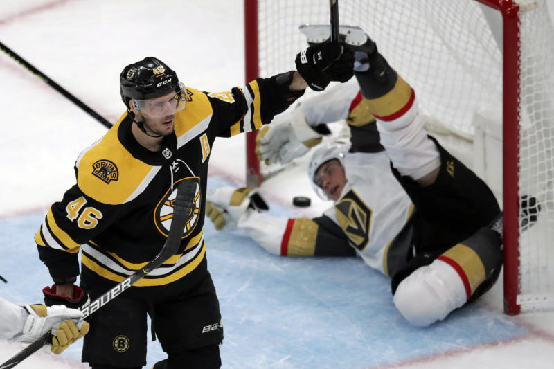 Boston Bruins center David Krejci (46) celebrates after scoring on Vegas Golden Knights defenseman Nick Holden, rear, during the third period of an NHL hockey game in Boston, Tuesday, Jan. 21, 2020. (AP Photo/Charles Krupa)