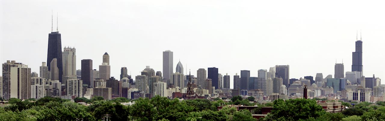 FILE - This June 23, 2006 file photo shows the Chicago skyline with the nation's tallest building, the Sears Tower, far right, now called the Willis Tower, and the John Hancock Center, left, the city's fourth highest skyscraper. Since the 9/11attacks on New York's World Trade Center a decade ago, much has changed at skyscrapers around the country, but experts say obvious precautions still leave thousands of buildings vulnerable because the costs to retrofit existing structures may be too costly and cities and states may be slow to adopt newer, tougher building codes for new construction like those recommended after the deadliest terror attack on U.S. soil. (AP Photo/M. Spencer Green, File)