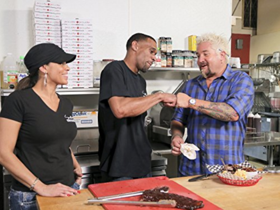 """<p>This was Guy Fieri's second show, but first in the hearts of his fans. The <a href=""""https://www.delish.com/restaurants/a58436/who-is-guy-fieri/"""" rel=""""nofollow noopener"""" target=""""_blank"""" data-ylk=""""slk:catchphrases"""" class=""""link rapid-noclick-resp"""">catchphrases</a> he spewed— <em>crackalack</em>, <em>funkalicious</em>, <em>righteous</em> — while visiting mom-and-pop restaurants across the country were almost as good as the down-home meals he'd spotlight weekly. Plus, he brought Smashmouth's lead singer (AKA his doppelganger) out of hiding for a cameo. Bless.</p>"""
