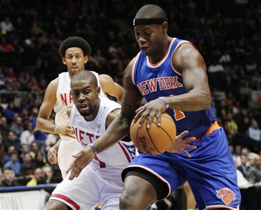 Brooklyn Nets' C.J. Watson (1) fouls New York Knicks' Ronnie Brewer (11) during the first half of a preseason NBA basketball game, Wednesday, Oct. 24, 2012, in Uniondale, N.Y. (AP Photo/Frank Franklin II)