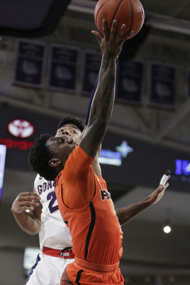 Pacific guard Lafayette Dorsey, front, shoots and is fouled by Gonzaga forward Rui Hachimura (21) during the first half of an NCAA college basketball game in Spokane, Wash., Thursday, Jan. 10, 2019. (AP Photo/Young Kwak)