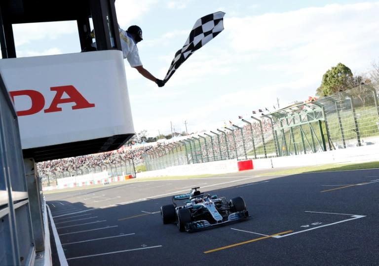 Mercedes' British driver Lewis Hamilton crosses the finish line to win the 2018 Japanese Grand Prix in Suzuka. This year's qualifying on Saturday could moved to Sunday as Typhoon Hagibis bears down on Japan