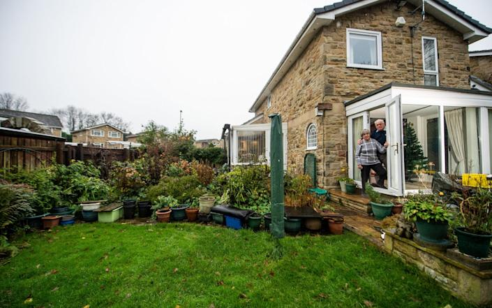 Sheila and Philip Herbert, whose house is in Tier 2 lockdown, while their garden is in Tier 3, near Leeds. The strange anomaly has risen because their home in Otley, West Yorks., is divided between Leeds City Council and Harrogate Borough Council - Alex Cousins / SWNS