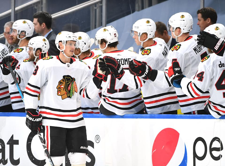 EDMONTON, ALBERTA - AUGUST 01:  Dominik Kubalik #8 of the Chicago Blackhawks celebrates his goal with teammates during the second period of Game One of the Western Conference Qualification Round against the Edmonton Oilers at Rogers Place on August 01, 2020 in Edmonton, Alberta. (Photo by Andy Devlin/NHLI via Getty Images)