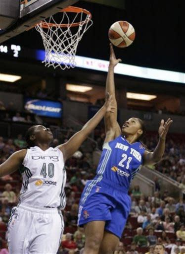 New York Liberty's Alex Montgomery (21) drives the lane as Seattle Storm's Shekinna Stricklen defends in the first half of a WNBA basketball game Friday, June 28, 2013, in Seattle. (AP Photo/Elaine Thompson)