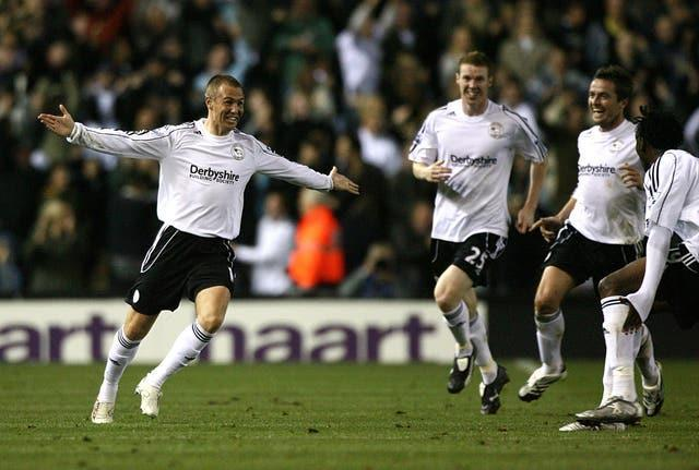 Kenny Miller, left, and Derby celebrate their winner against Newcastle