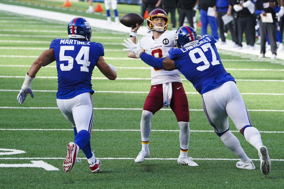 New York Giants defensive tackle Dexter Lawrence (97) and Blake Martinez (54) rush Washington Football Team quarterback Kyle Allen (8) during a point after try in the second half of an NFL football game Sunday, Oct. 18, 2020, in East Rutherford, N.J. The point after try was unsuccessful. (AP Photo/John Minchillo)
