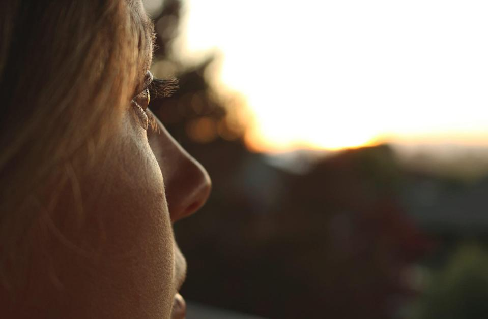 An image of a woman looking out into a distance.