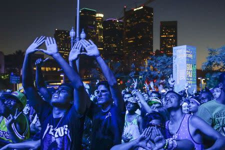 Attendees dance during the Made in American music festival in Los Angeles, California August 31, 2014. REUTERS/Jonathan Alcorn