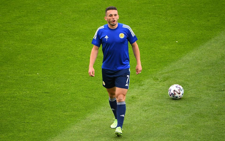 ohn McGinn of Scotland warms up prior to the UEFA Euro 2020 Championship Group D match between Scotland v Czech Republic - Andy Buchanan - Pool/Getty Images