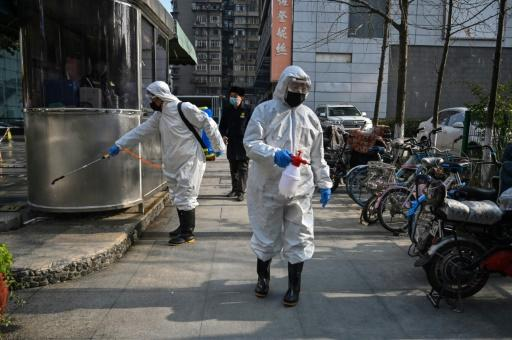 Workers disinfect parts of Wuhan