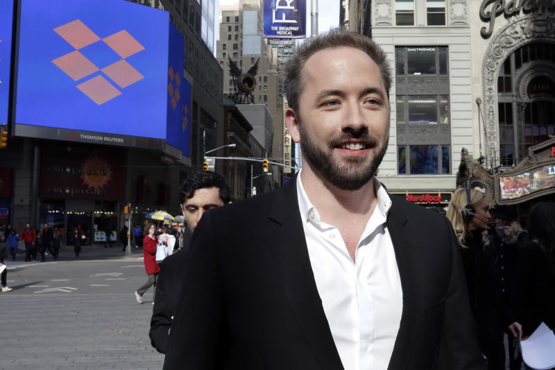 Dropbox co-founder Drew Houston at the Nasdaq MarketSite during the company's IPO, in New York's Times Square, Friday, March 23, 2018. (AP Photo/Richard Drew)