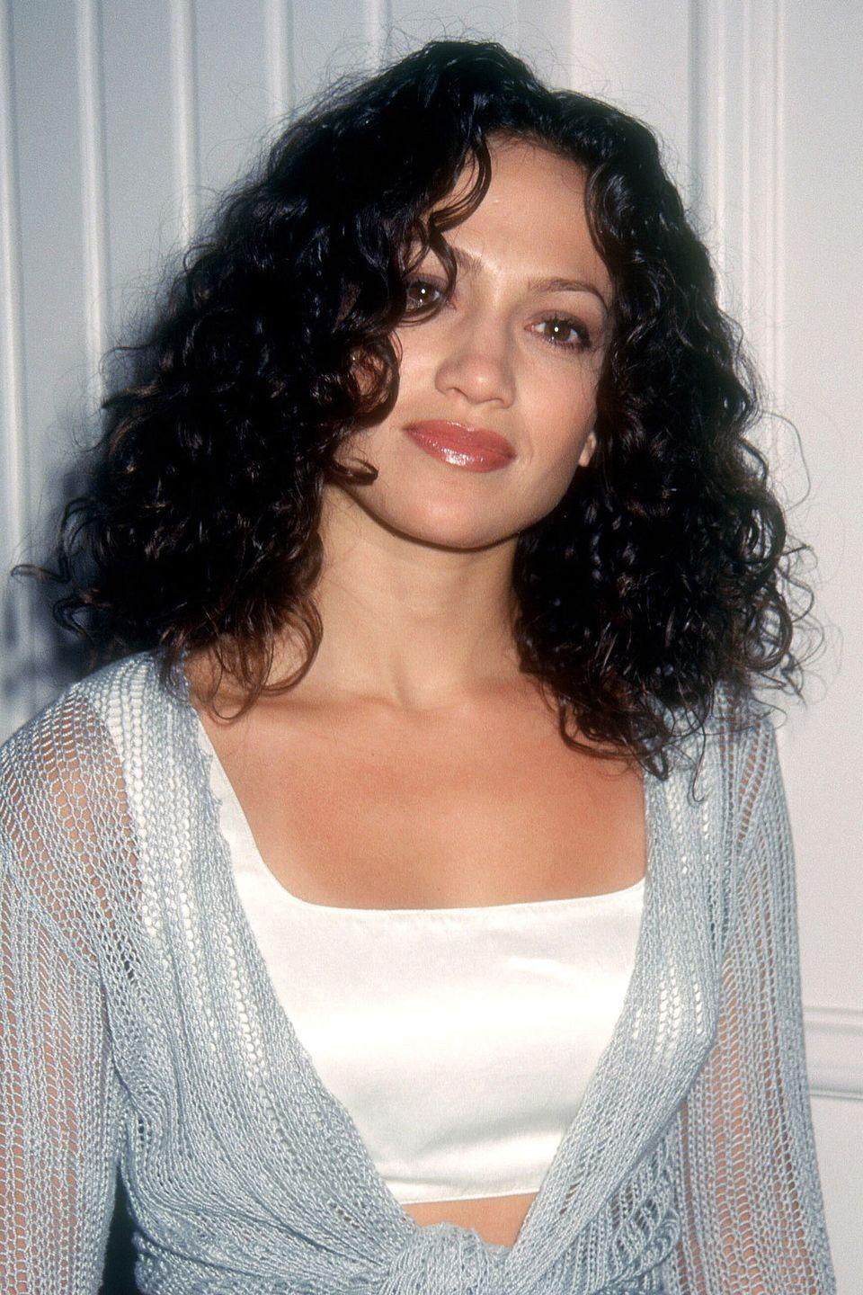<p>Early on in her career, J.Lo hadn't started messing with foils yet, taking on Hollywood as a brunette bombshell.</p>