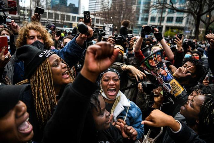 People celebrate as the verdict is announced in the trial of former police officer Derek Chauvin outside the Hennepin County Government Center in Minneapolis, Minnesota on April 20, 2021. - Sacked police officer Derek Chauvin was convicted of murder and manslaughter on april 20 in the death of African-American George Floyd in a case that roiled the United States for almost a year, laying bare deep racial divisions. (Photo by CHANDAN KHANNA / AFP) (Photo by CHANDAN KHANNA/AFP via Getty Images)