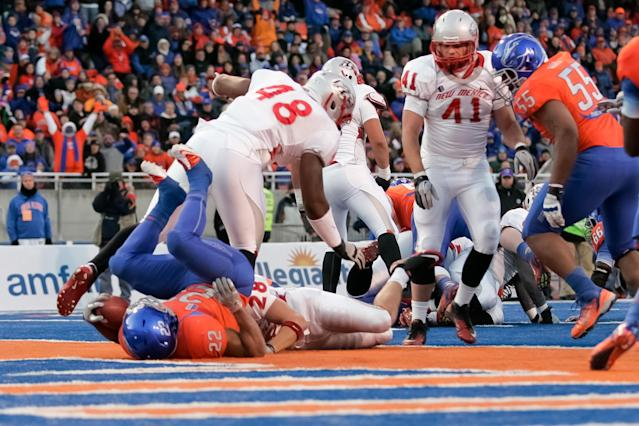 BOISE, ID - DECEMBER 03: Doug Martin #22 of the Boise State Broncos rolls backwards into the end zone for a touchdown against the New Mexico Lobos at Bronco Stadium on December 3, 2011 in Boise, Idaho. (Photo by Otto Kitsinger III/Getty Images)
