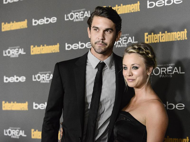 FILE - This Sept. 20, 2013 file photo shows actress Kaley Cuoco, right, and Ryan Sweeting at the 2013 Entertainment Weekly Pre-Emmy Party in Los Angeles. After a quick courtship, Cuoco is engaged to tennis pro Ryan Sweeting, her rep confirms. The 27-year-old actress and 26-year-old Sweeting began dating about three months ago. (Photo by Dan Steinberg/Invision/AP, File)