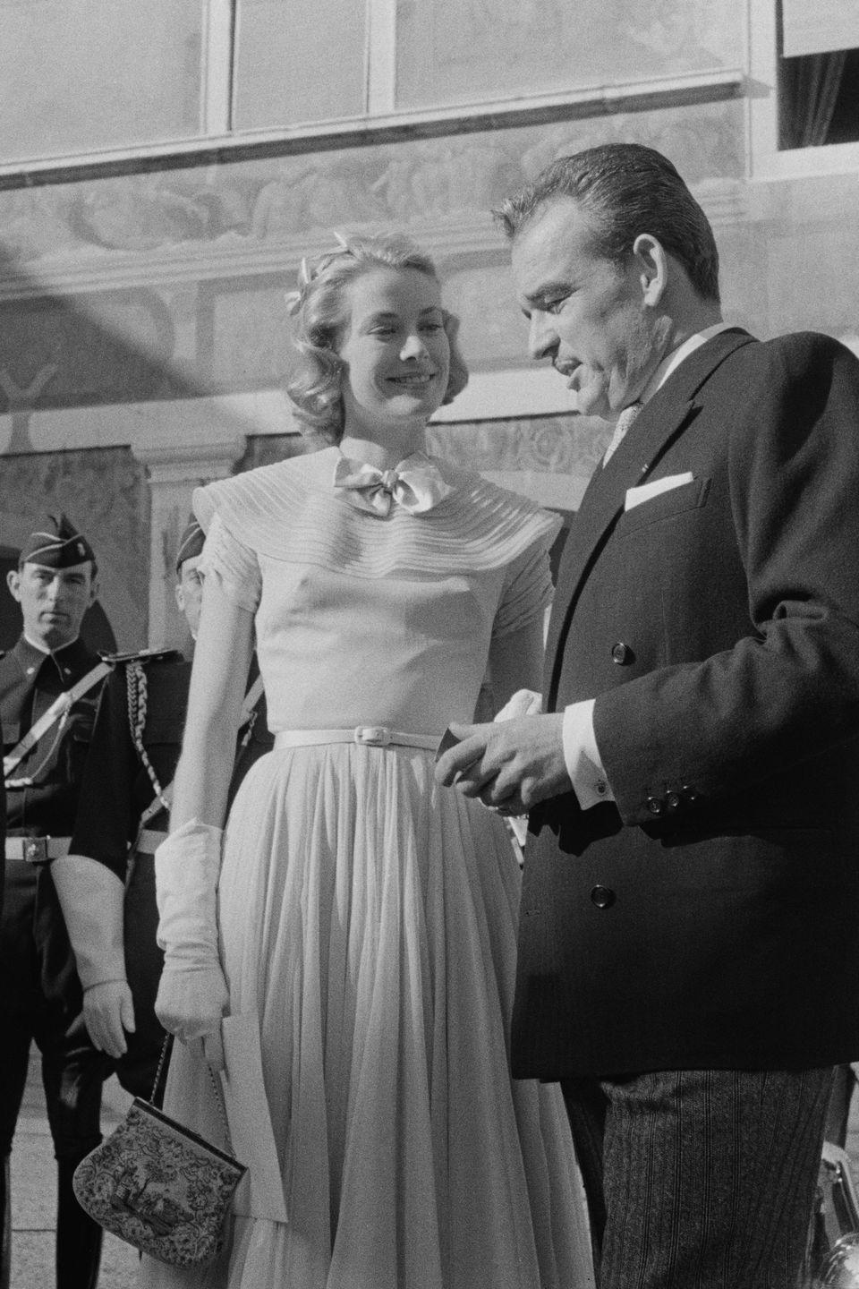 """<p>To accept wedding congratulations at a quick press conference, the actress donned another tea-length ensemble on April 18, 1956. It wasn't her last look of the day, either. She slipped into a white silk Lanvin gown that night at a gala, <a href=""""http://www.brides.com/story/grace-kelly-wedding-photos"""" rel=""""nofollow noopener"""" target=""""_blank"""" data-ylk=""""slk:Brides"""" class=""""link rapid-noclick-resp""""><em>Brides</em></a> reports. </p>"""
