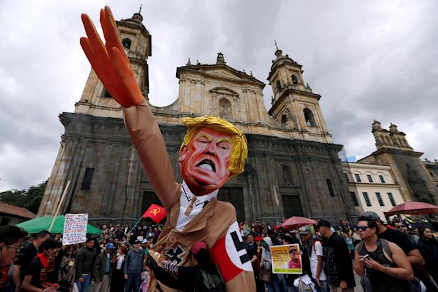 <p>Protesters carry a cutout depicting U.S. President Donald Trump, wearing a Nazi uniform, during a rally commemorating May Day in Bogota, Colombia May 1, 2018. (Photo: Jaime Saldarriaga/Reuters) </p>